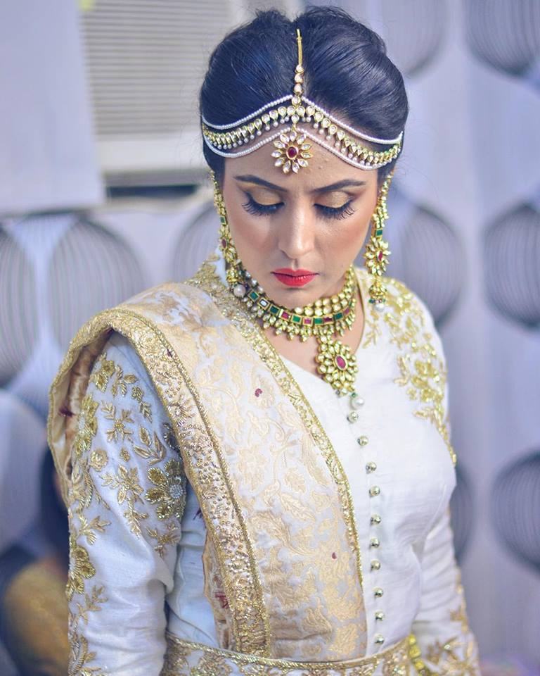 Bride in white lehenga